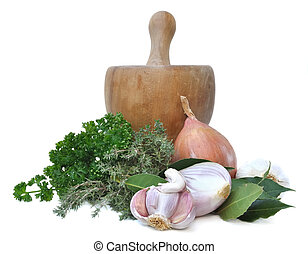 herbs and onions garlic with a wooden pestle