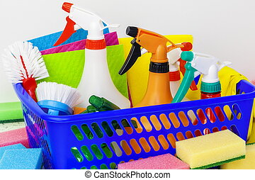 Various home cleaning products in the basket