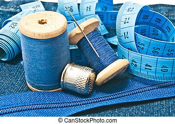various items for needlework on white