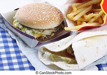 Various junk food on table - Various tasty junk food on ...