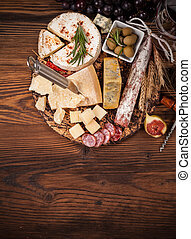 Various kind of cheese - Cheese arrangement served on...