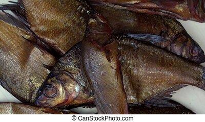 Various kind of smoked fish food. Rotating turntable...