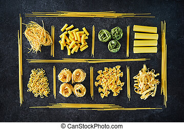 Various kinds of pasta over stone background.