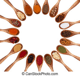 Various kinds of spices on wooden spoons isolated on white background. Free space for text inside