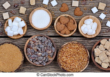 Various kinds of sugar in a bowls on table
