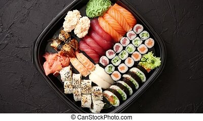 Various kinds of sushi on plate or platter set - Japanese...