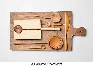 Various kitchen utensil on white wooden background. Cutting...