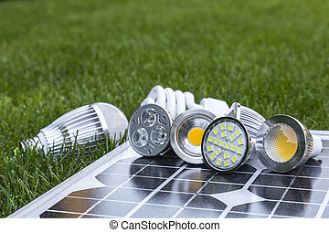 various LED lamps on photovoltaic cells and CFL in the grass...