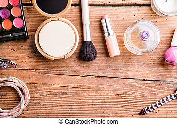 Various make-up products laid on table. Copy space