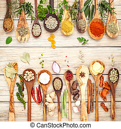 Various of spices and herbs in wooden spoons
