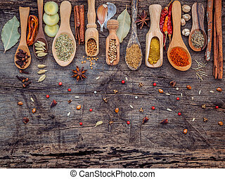 Various of spices and herbs in wooden spoons. Flat lay of...