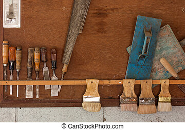 Various old craftsman tools on wall