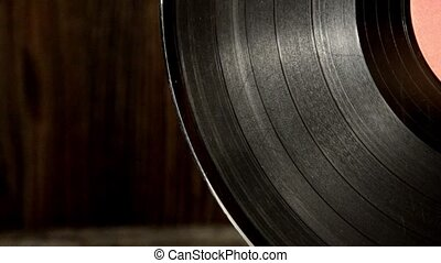 Various old vinyl records on the old wooden background