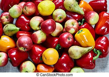 Various paprika, orange, pear, apple on a gray canvas