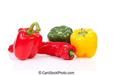 Various paprika over white background