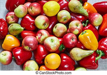 Various paprika, pear, apple, orange on a gray canvas