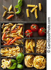 various pasta in black wooden box