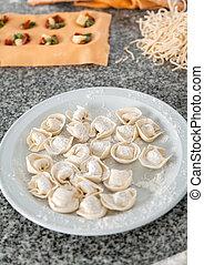 Various Pastas On Countertop In Kitchen