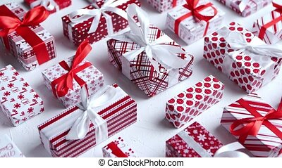 Various pattern and size Christmas boxes placed on white background. Wrapped in festive paper. Xsmas theme concept. Flat lay
