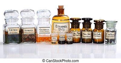 Various pharmacy bottles of homeopathic medicine on white background