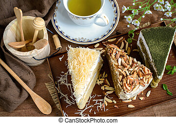 various pieces of cake with cup of tea