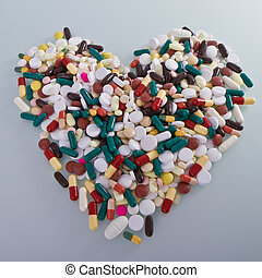 various pills in a shape of heart