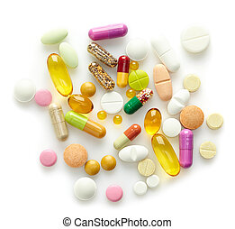 various pills on a white background
