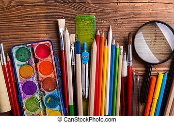 Various school and art supplies, wooden table, flat lay -...