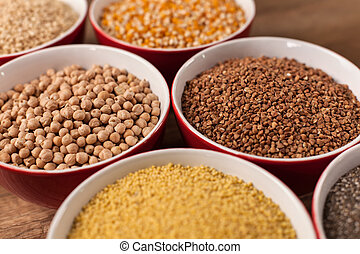 Various seeds and grains in bowls - close up