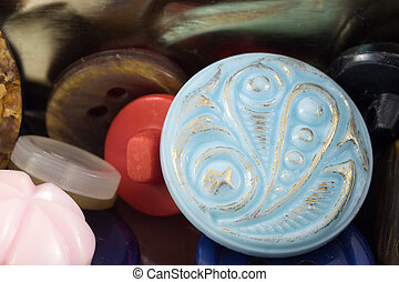 Various sewing buttons set on metal background.  Vintage colorful buttons.