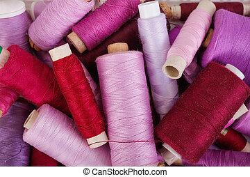 Various shades of purple threads