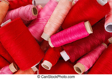 Various shades of red threads