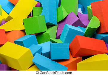 Various shape colorful wooden toy blocks.