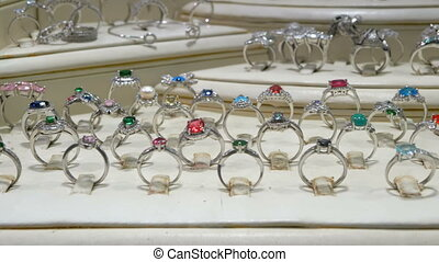 Various silver rings with precious stones and Jewelry made...