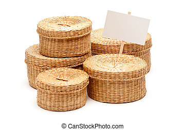 Various Sized Wicker Baskets with Blank Sign on White