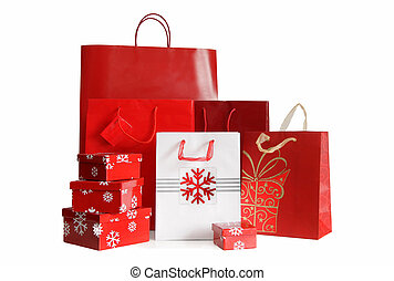 Various sizes of holiday shopping bags and gift boxes on white background