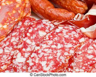 various sliced meat specialties on plate