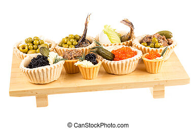 Various snacks in plate on banquet table