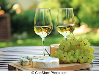 Various sorts of cheese and white wine - Various sorts of...