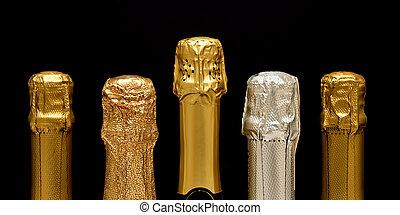 Various sparkling wine bottle necks