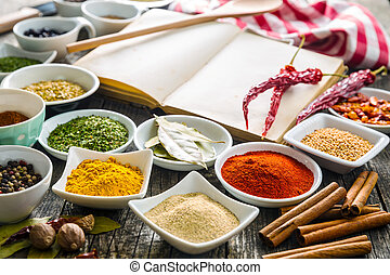 Various spices and blank cookbook.