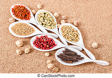 various spices and herbs on sack.