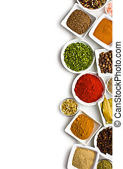 Various spices and herbs on white background.