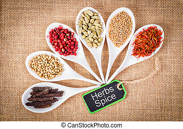 various spices and herbs with herbs spices wooden tag.