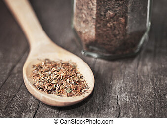 various spices in wooden spoon