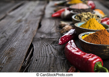 Various spices selection - Spices on wooden bowl background