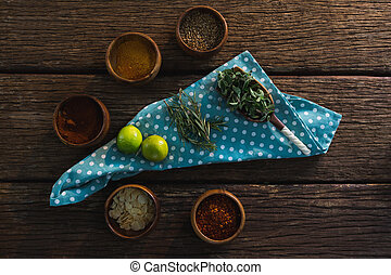 Various spices with herbs on wooden table