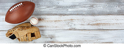 Various sports equipment on white rustic wood with plenty of copy space