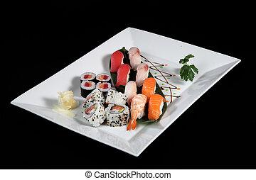 various sushi and sashimi on rectangular plate