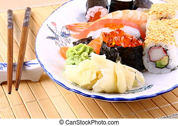 Various sushi, chopsticks and red caviar, close up